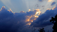 08-12-12 Clouds & the setting sun... after the storm.